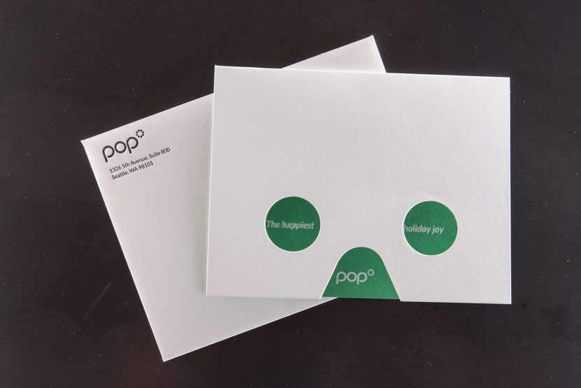 white foil on green paper holiday greeting card design die cut mask design