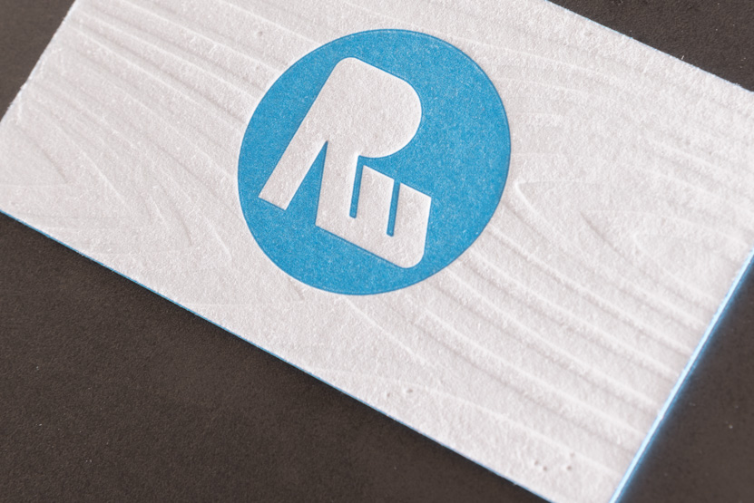 white and blue letterpress business card